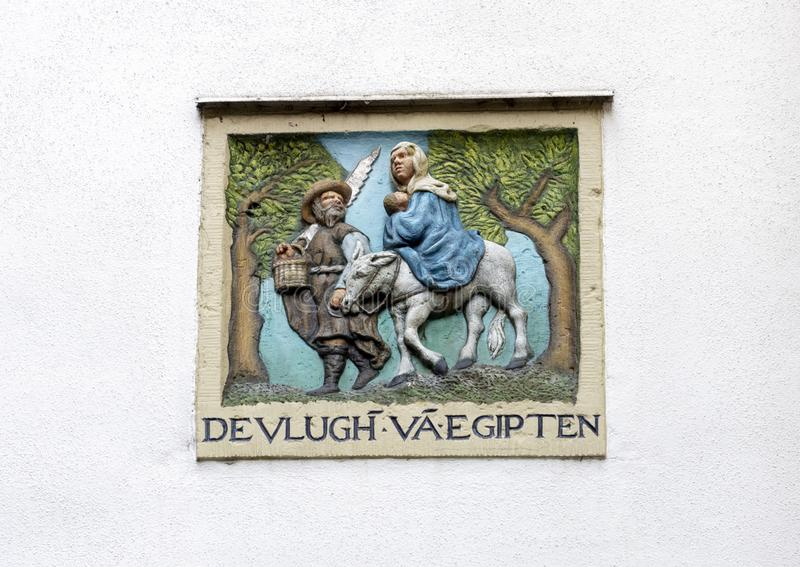 """""""DEVLUGH VA EGIPTEN """"su una parete in bianco bianca sul Begijnhof, Amsterdam immagine stock libera da diritti"""