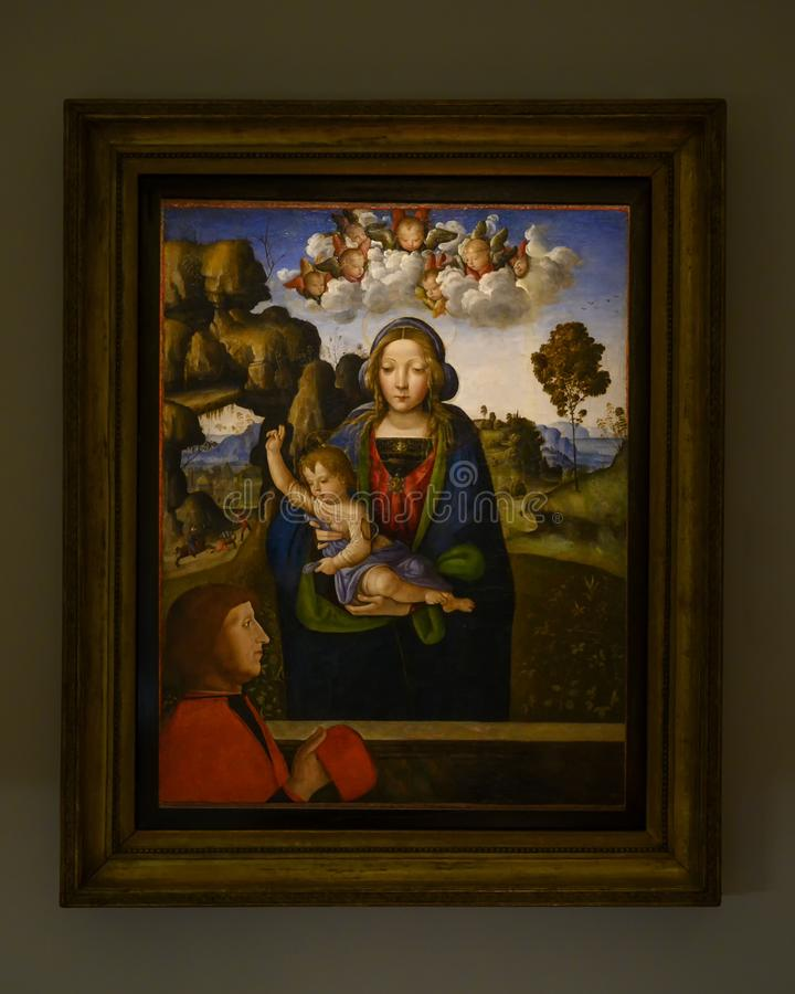 """""""Madonna ed il bambino con un adoratore """"nel Pinacota Ambrosiana, la galleria di arte ambrosiana a Milano, Italia fotografie stock"""