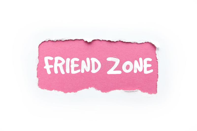 """""""Una zona dell'amico """"in un fondo bianco e rosa lacerato immagini stock libere da diritti"""
