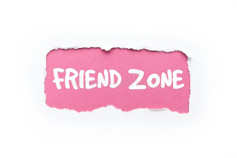 一个'朋友区域'在被撕毁的白色和桃红色背景中 免版税库存图片