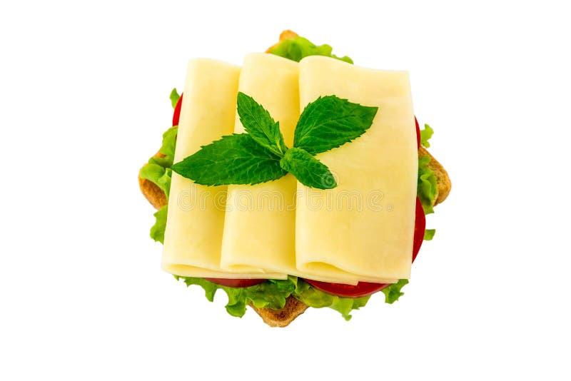 一个三明治用乳酪,蕃茄,在白色被隔绝的背景 图库摄影