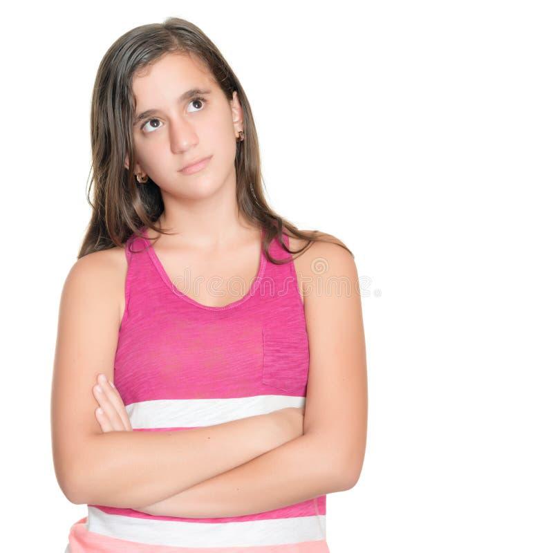一个严肃的十几岁的女孩的画象有一个周道的表示的 免版税图库摄影