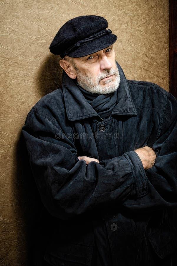 一个人的画象有胡子和盖帽的 库存图片