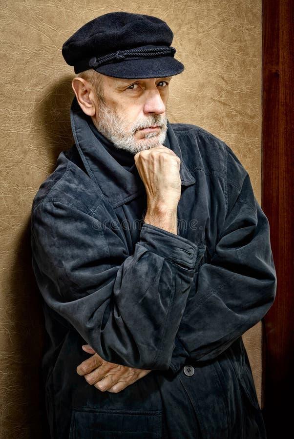 一个人的画象有胡子和盖帽的 图库摄影