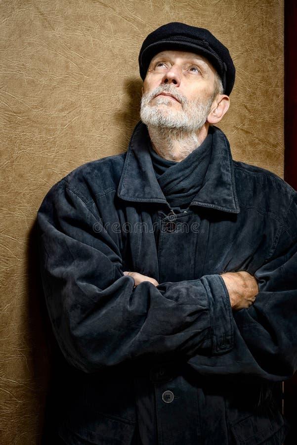一个人的画象有胡子和盖帽的 免版税库存照片