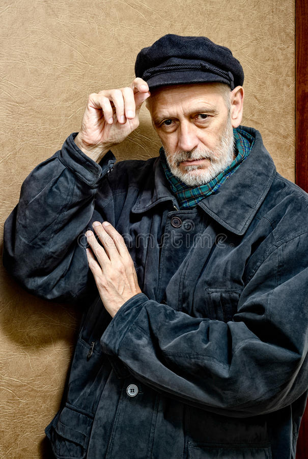 一个人的画象有胡子和盖帽的 库存照片