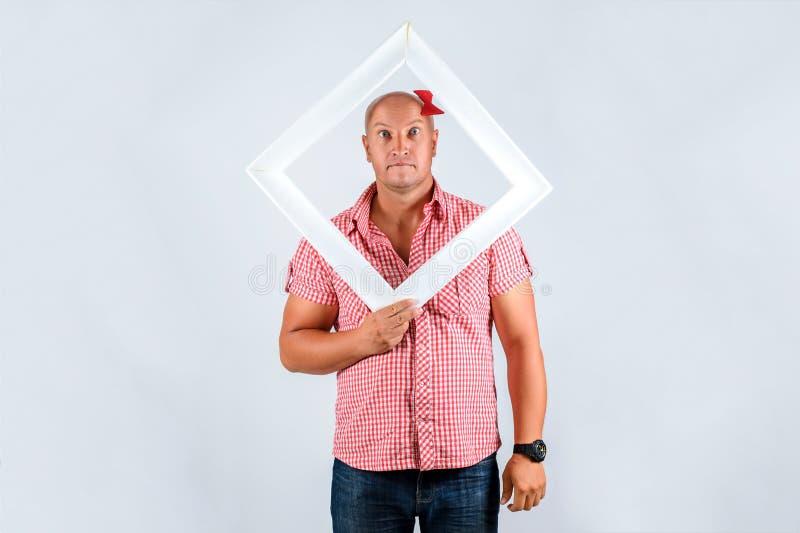 一个人的美丽的画象白色背景的,正面心情 免版税库存照片