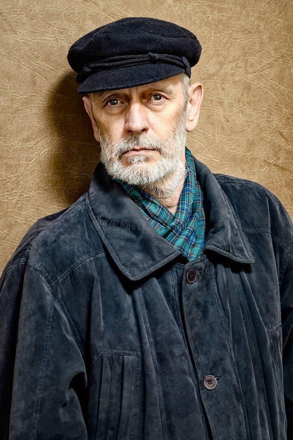 一个人的画象有胡子和盖帽的 免版税库存图片