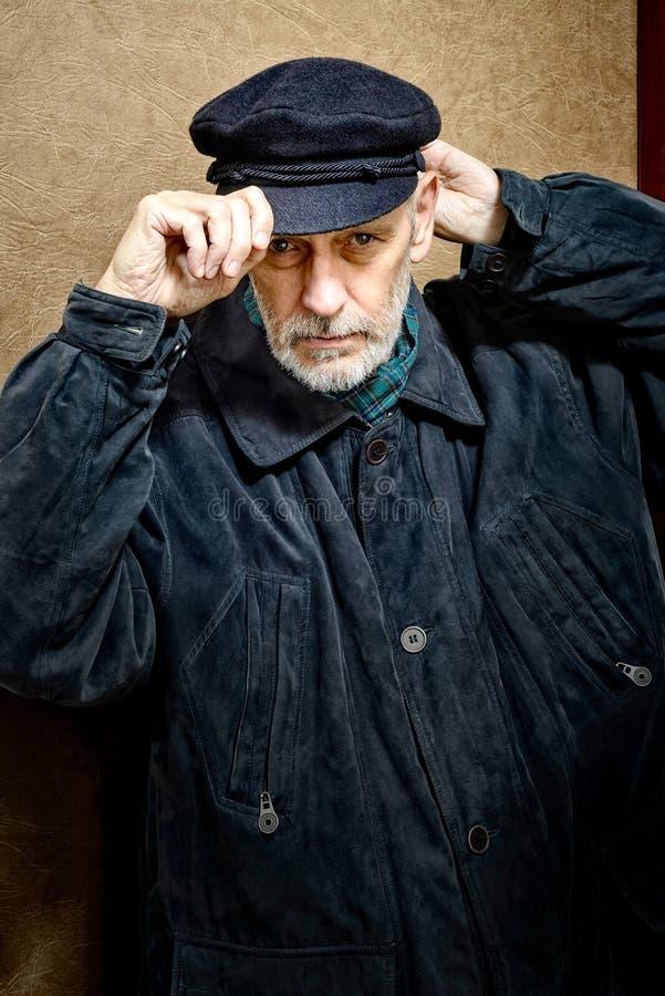 一个人的画象有胡子和盖帽的 免版税图库摄影