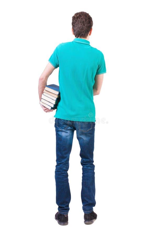 一个人运载重的堆书 回到视图 库存图片