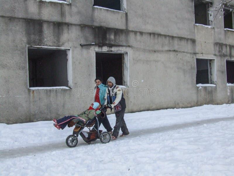 一个可怜的家庭的残疾儿童 免版税库存照片