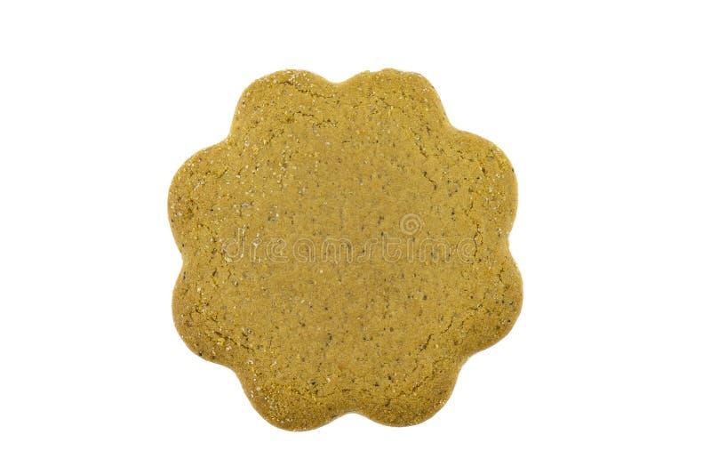 一个唯一姜曲奇饼的一张顶上的照片,隔绝在白色背景 库存照片
