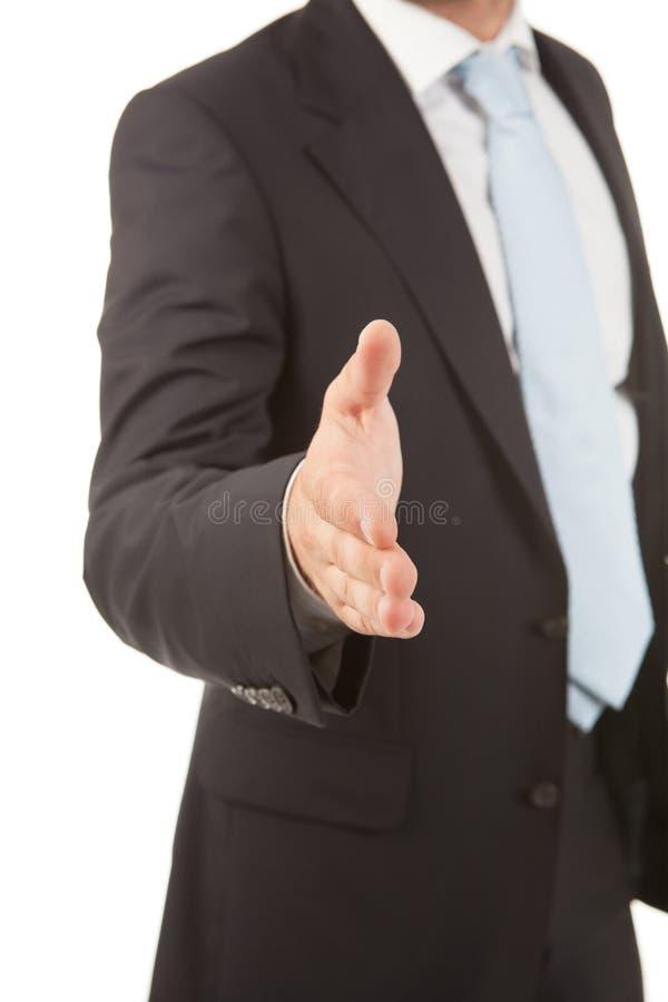 一个商人的细节用准备好一只开放的手密封成交 图库摄影