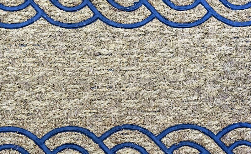 一个地毯的纹理从粗砺的纤维的 设计和装饰的背景 免版税图库摄影