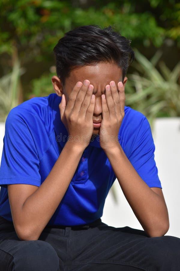 一个失望的少年男孩 库存图片