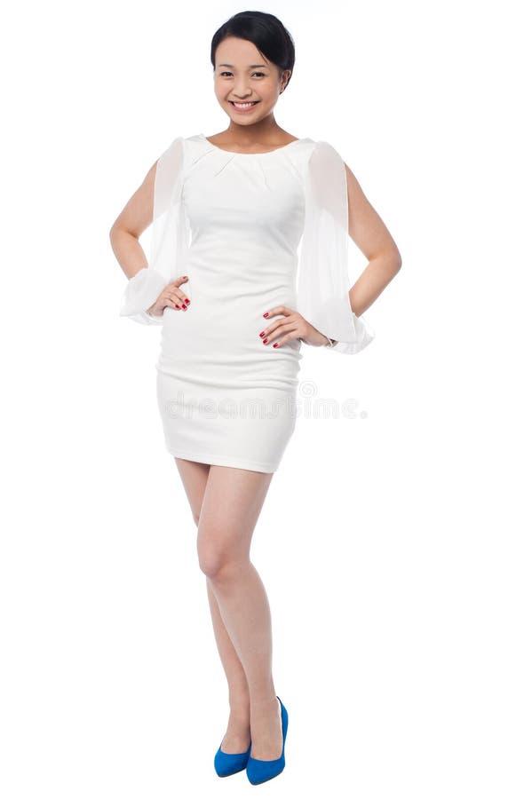 一个女孩的全长画象党穿戴礼服的 库存照片