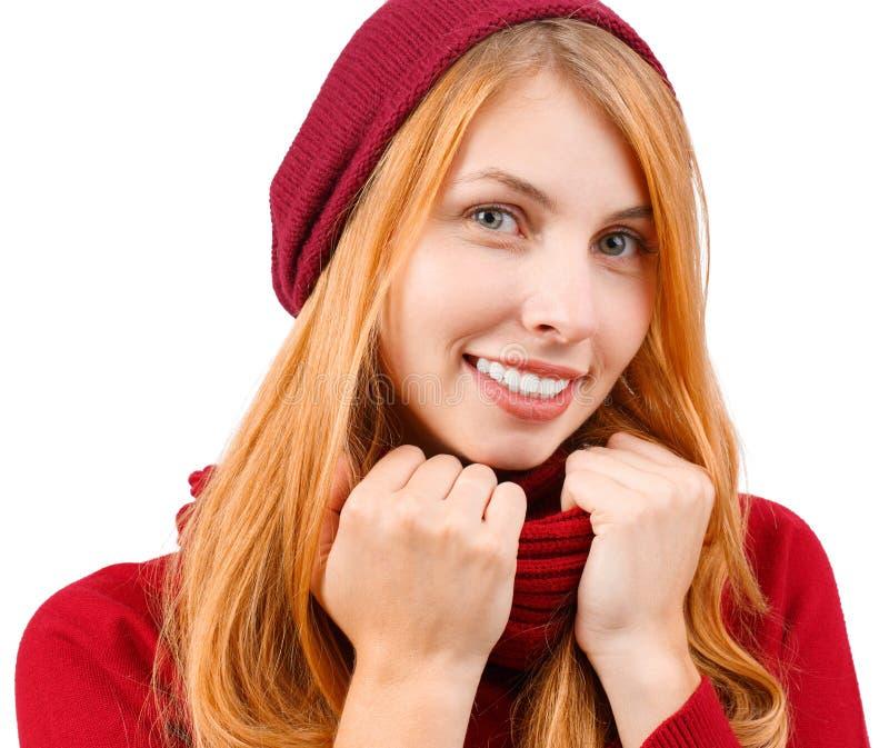 一个女孩的画象在红色衣裳穿戴了 女孩坚持她的围巾用两只手 查出 库存图片
