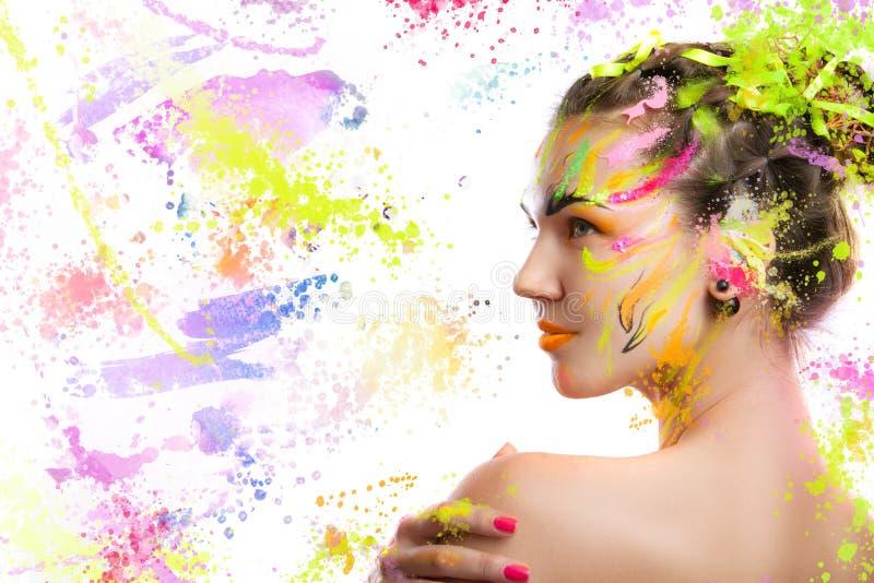 一个女孩的画象油漆的 免版税库存图片