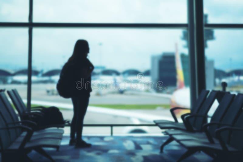 一个妇女旅客在机场 库存照片