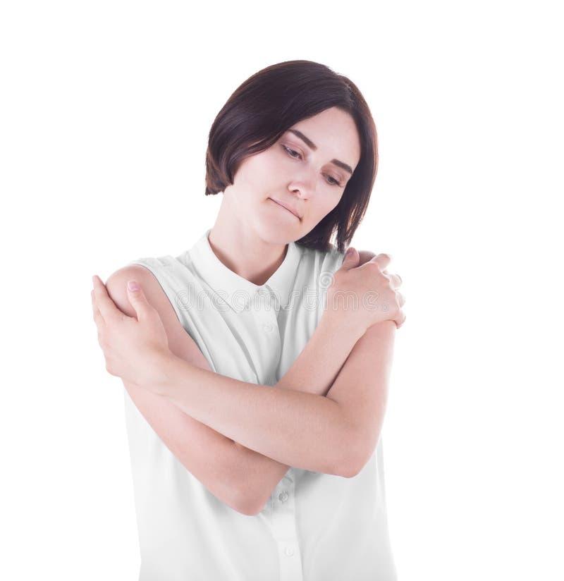一个孤独的失望的少妇是冷的,隔绝在白色背景 失望和消沉 人面表示 免版税库存照片