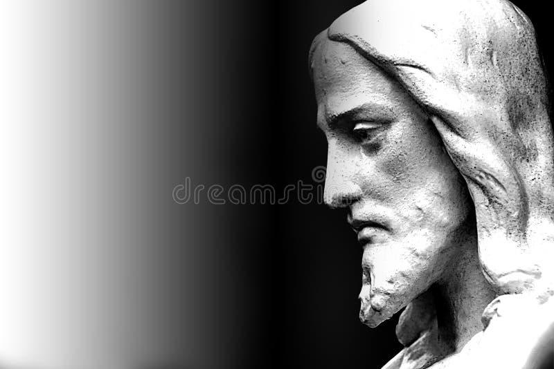 一个宗教耶稣雕象的表面 库存照片