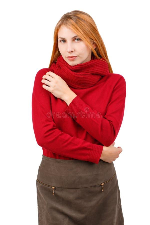 一个害羞的女孩拥抱自己与困窘 O 库存图片
