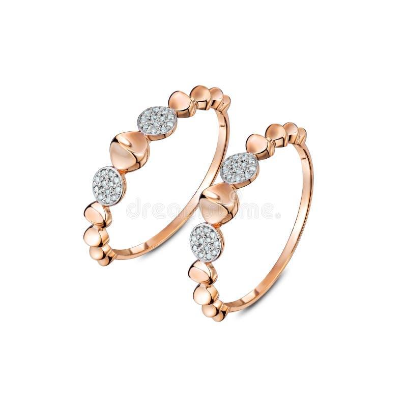一个对与金刚石的豪华玫瑰色金戒指 免版税库存图片