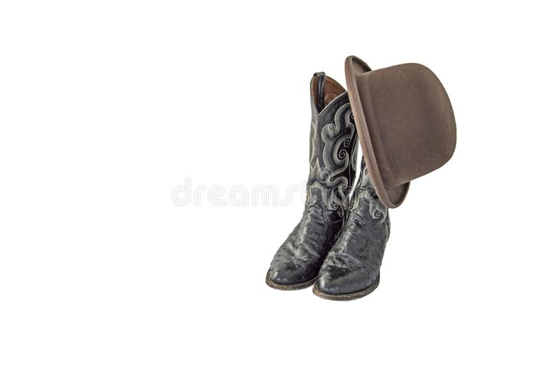 一个对有一床棕色毛毡的德比花梢黑牛仔靴 库存照片