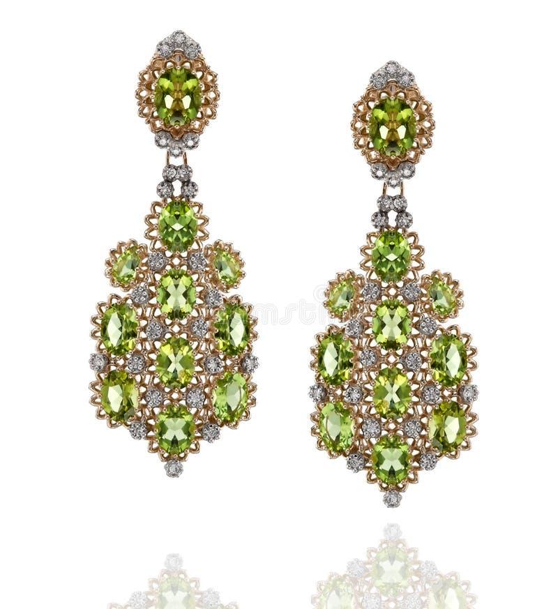一个对有金刚石和绿色青玉的黄色和人造白金耳环 库存图片