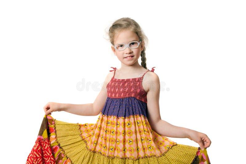一个小女孩的画象是佩带sundress 库存图片