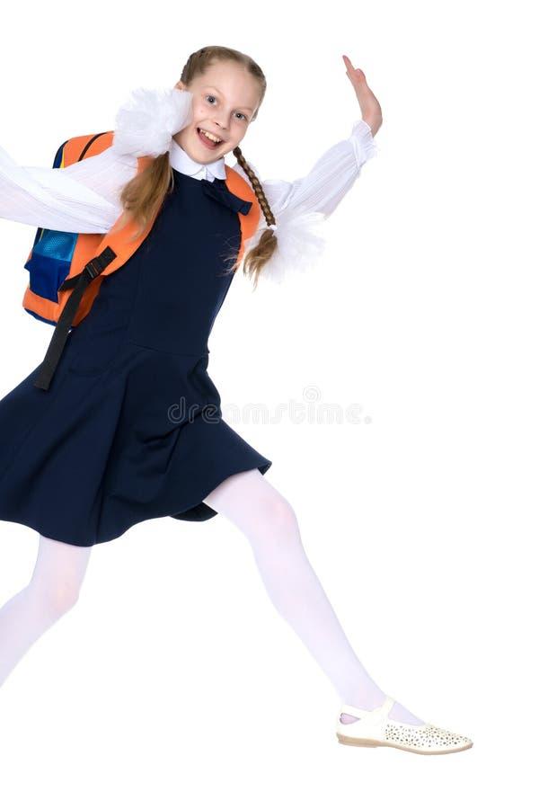 一个小女孩赶紧到学校 库存照片