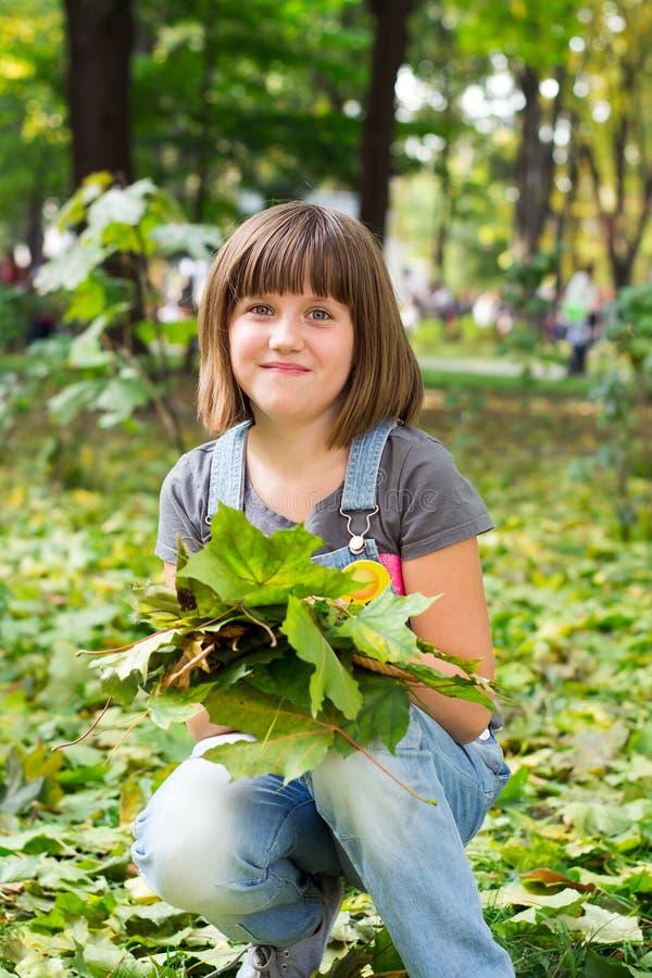 一个小愉快的女孩的画象 免版税库存照片