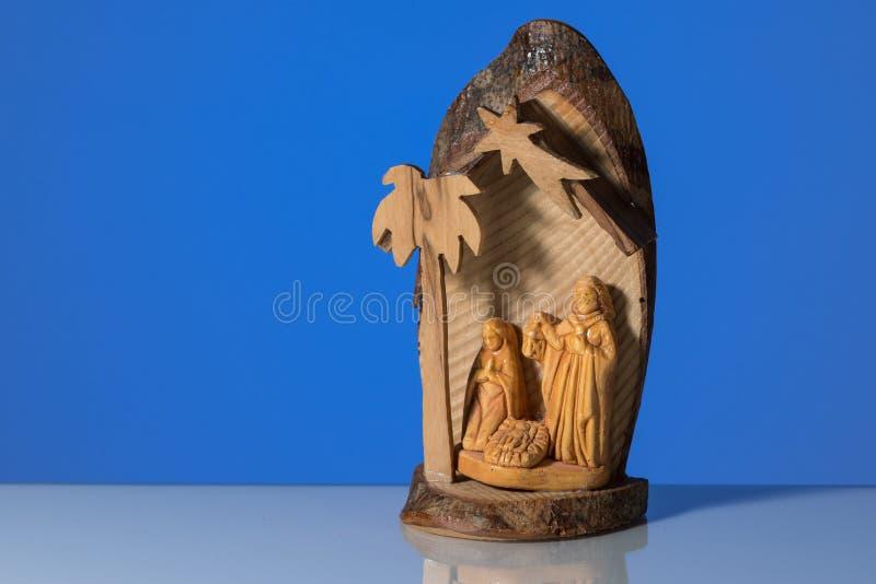 一个小木圣诞节小儿床的特写镜头 免版税库存图片