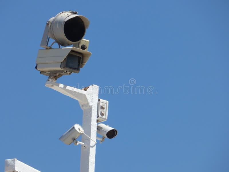 一个小组在杆的监视器 免版税库存照片