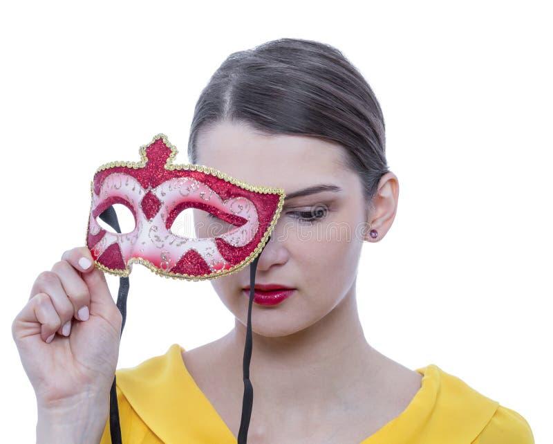 一个少妇的画象有面具的 免版税库存照片