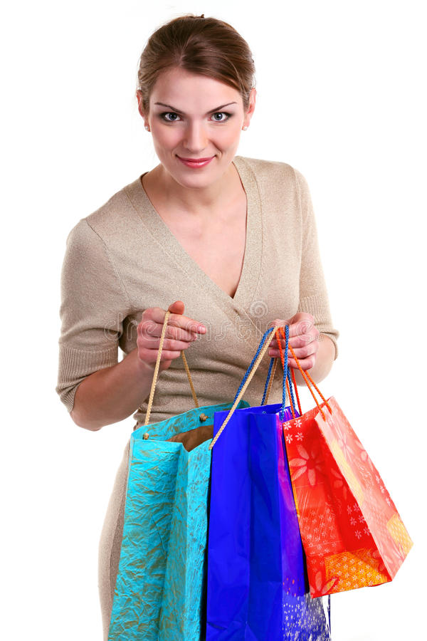 一个少妇的纵向有购物袋的 图库摄影