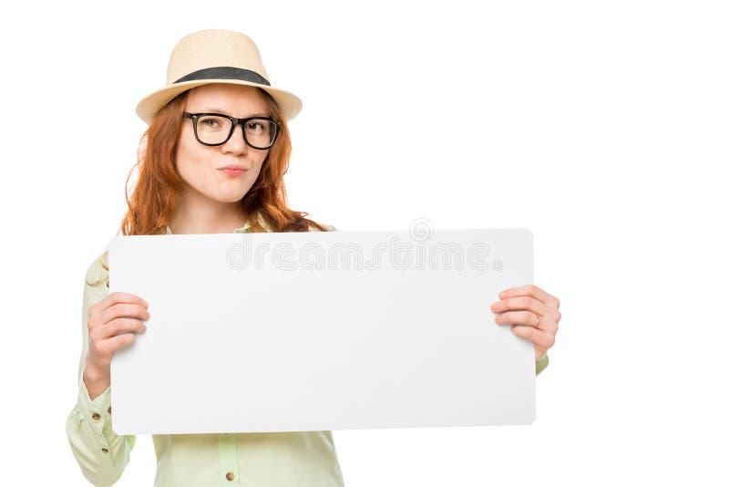 一个帽子的美丽的女孩有横幅的 免版税图库摄影
