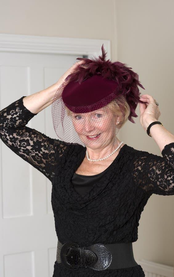 一个帽子的年长妇女有面纱的 免版税图库摄影