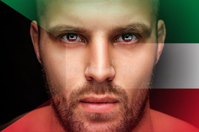 一个年轻严肃的人的画象,在眼睛被反射国旗 免版税库存图片