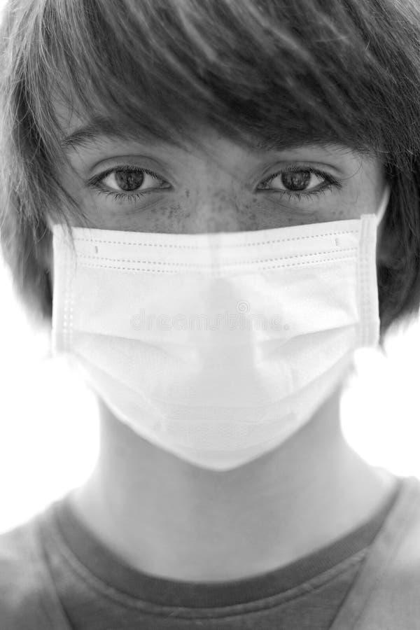 一个年轻人的画象一个防护医疗面具的 图库摄影