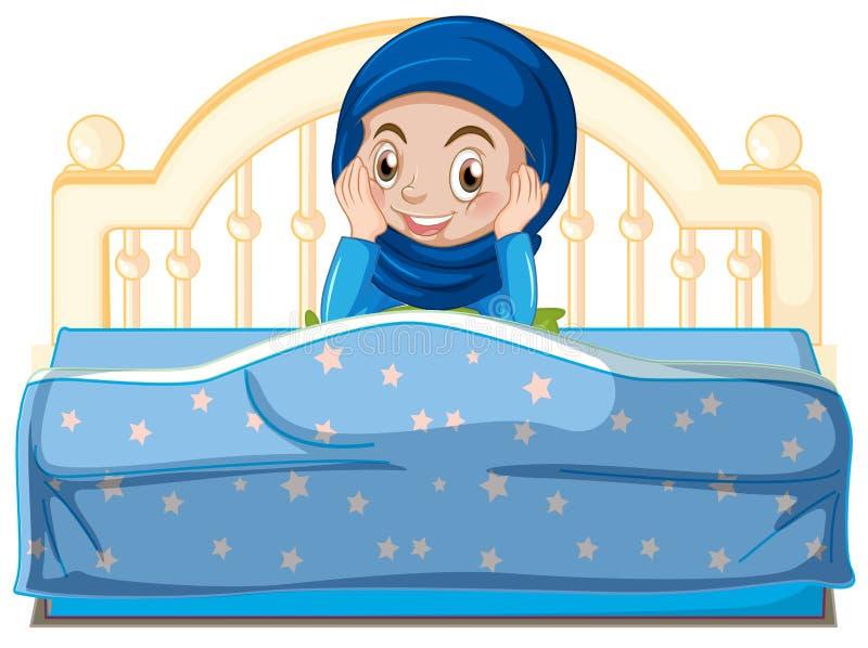一个年轻回教女孩在床上 库存例证