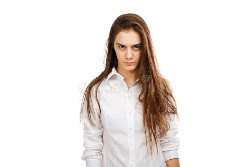 一个年轻恼怒的女孩的画象白色背景的 库存图片