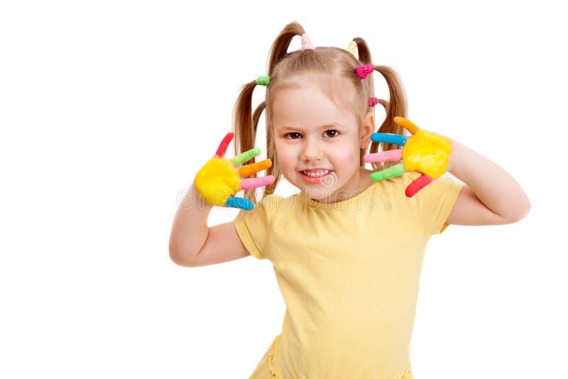 一个微笑的女孩用被绘的手 免版税库存照片