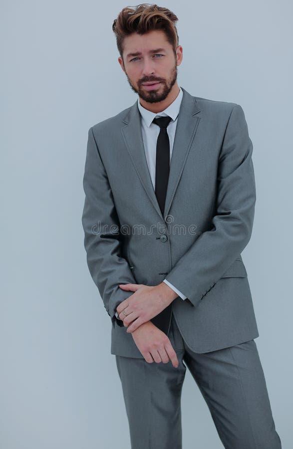 一个微笑的英俊的商人的画象在白色backgrou的 库存图片