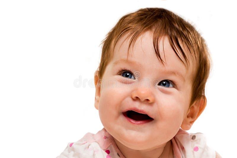 一个微笑的婴孩的面孔 库存照片