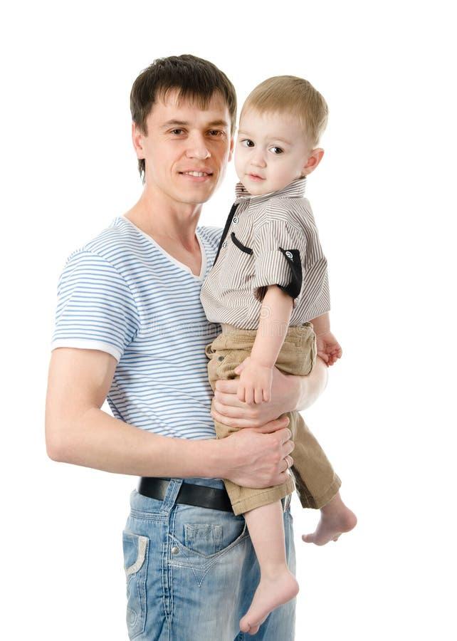 一个愉快的父亲的画象有他的小儿子的 隔绝在丝毫 免版税库存照片