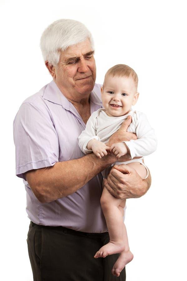 一个成熟祖父举行的孙子的画象 库存照片