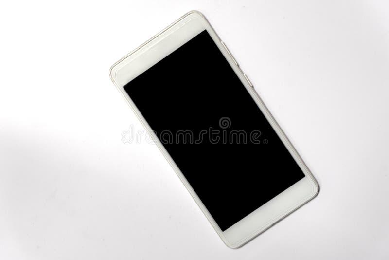 一个手机在一张白色地板桌被安置 r 库存照片