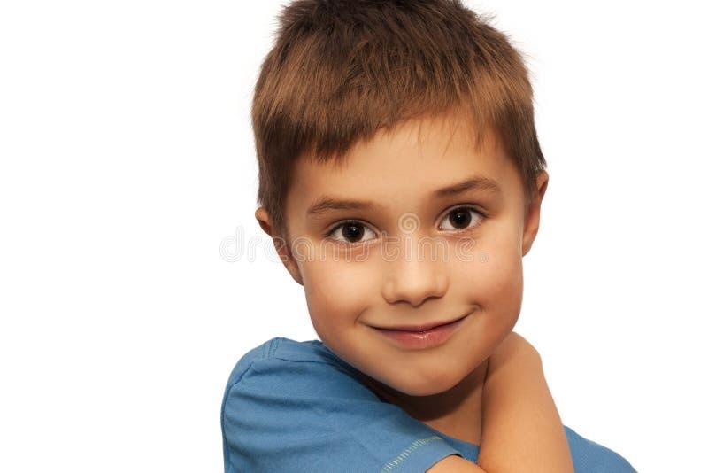一个新男孩微笑 图库摄影