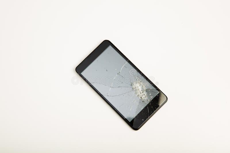 一个智能手机的特写镜头有残破的显示的 免版税库存照片